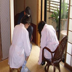 years ; on the right: the center s director Mieko Hariki and a foreign client bowing to each other after a Naikan interview interpreted by the author